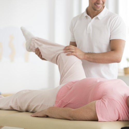 Senior ward undergoing pnf rehabilitation program led by a professional physiotherapist physiotherapist